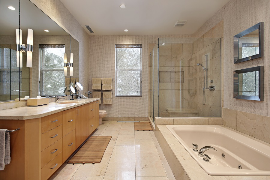 Master bath in luxury home with oak wood cabinetry