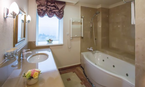 luxury bathroom interior complete with granite and beautiful tiled floors and walls.